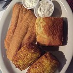 catfish dinner, with fried corn on the cob and jalapeño cornbread