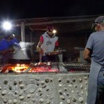 Cooking the fish on the hot coals
