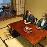 Enjoying tea in the room, wearing the kimonos