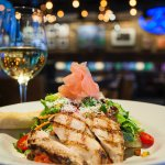 The Cowgirl Salad with grilled chicken is just one of the many healthy options on our menu!