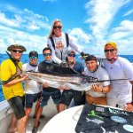 Mark (center) with our group and sailfish we caught.