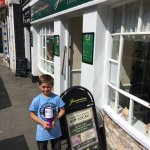 Grandson collecting the Asthma UK charity bottle which contained another £25.