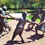 Sculpture children playing around