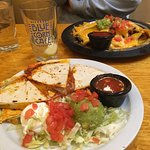 Your standard quesadilla. In the background, Nachos, which were better than the quesadilla
