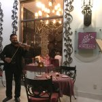 The amazing violinist who plays for the outside seating areas of Bordeaux, El Patio and Portofin