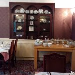 Part of the dining room with the different cereals and drink selections.