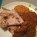 Chicken with peppercorns, tarka Dahl and Rogan Gosht. Moped up with a roti. Yum.
