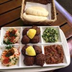 The chef kindly exhanged the items containing dairy for extra falafel and humus.