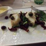 Baccala' capperi olive pomodorini sott'olio e una salsina delicata.