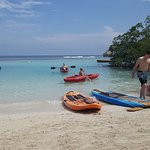 Beach with kayak and paddle board