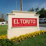 Street signage for El Torito restaurant in Tustin, CA