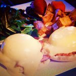 Eggs benedict with potatoes and side salad