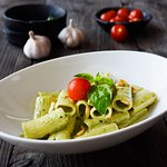 Rigatoni in homemade basil pesto sauce