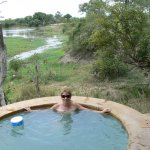 Cabin outdoor swimming pool - the view of the hippo ond in the background.