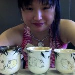 Brushpainted rabbit teabowls by Tracie Griffith Tso in studios 22 and 19.