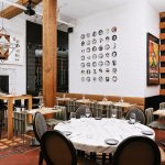 Cibo Trattoria - Main Dining Room with original 1908 terracotta floors and wood beams.