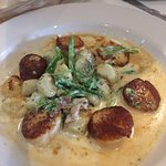 Seared scallops with gnocci, prosciutto, & green beans in a great sauce.