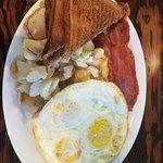 Eggs, bacon, toast, potatoes