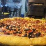 Un lugar para disfrutar de la buena pizza solo, en pareja o en familia