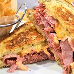 Reuben w/fries...packed with corned beef and cheese. GREAT!