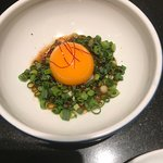 Egg with spring onion for the steak tartare.