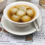 Glutinous rice ball filled with black sesame in ginger soup