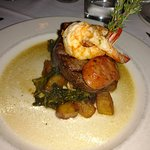 Filet Mignon with shrimp, roasted potatoes and greens