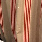 Worn curtains.