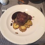 Steak with potatoes, onions and mushrooms