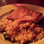 A beautifully made nut encrusted salmon with couscous medley