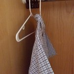 A total of TWO hangers available with no iron or other amenities.
