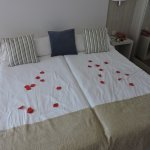 Rose petals placed on or bed prior to our arrival