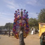 colourful windmills sold outside Kankaria Lake