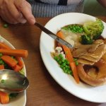 Roast pork with roast potatoes, steamed vegetables (and if room a free dessert or coffee)