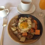 Duck confit hash with jalopeño cream and farm egg over-easy