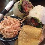 Steak burrito with slaw and beef brisket burrito with chipotle sweet potato salad