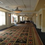 Banquet rooms to right. Glass doors to left open to a large full length elevated patio area