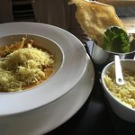 Chicken Korma with rice, popadum and lettuce.