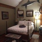 Comfy queen size bed in Ships Wheel Suite