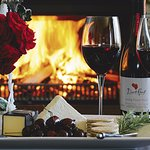 Enjoy complimentary aperitifs in front of a roaring fire
