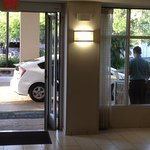 employee opens front door to listen for phone calls, makes lobby smell like smoke.
