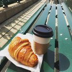 A croissant and latte on Dufferin Terrace