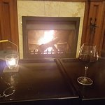 enjoying a great wine by the fire