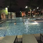 The multi colored fountains in the lake and the pool at night!