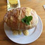 Apple and raisin pie with custard