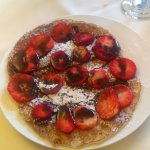 Crepe with strawberries and chocolate sauce