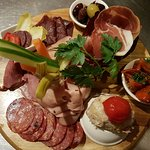Charceuterie board to share: changing combinations of local smoked, cured and dried meats