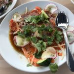 ;  Ōra King salmon carpaccio with cucumber, radish, red onion, coriander & ginger-soy dressing