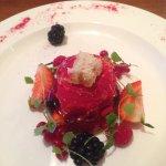 Elderberry jelly dessert, blackberries, strawberries, redcurrants, honeycomb square.