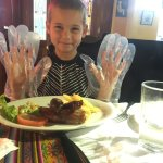 my son with his half of the rib plate